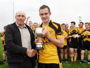 Adrian Carey receives the cup from John O''Boyle