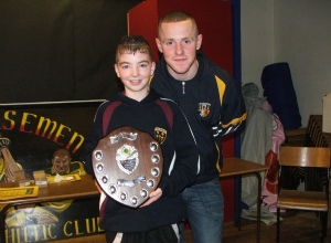 U12 Captain Ryan McGuigan received U12 League Trophy from Antrim Football Captain Paddy Cunningham