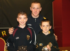 Joint U12 POTY's Ryan McGuigan and Michael Hagan receive their awards from Paddy Cunningham
