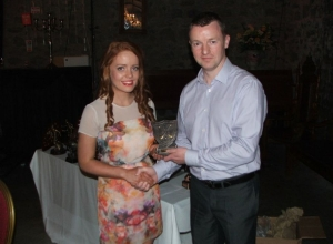 Una Doherty received the U16 POTY award from Paul McKee