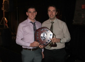 Paddy Kelly receives Senior POTY from manager Michael McMullan