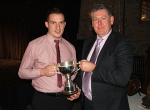 Reserve Captain Adrian Carey receives Div 2 Reserve Trophy from Columb Walsh