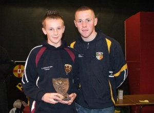 U14 POTY Conall Delargy receives his award from Paddy Cunningham