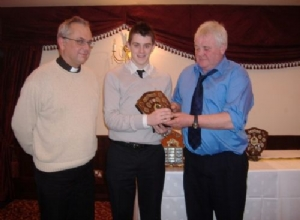 Minor Player of the Year - Aidan McKee receives award from Micky Kelly and Fr Aidan.