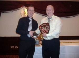 Junior Player of the Year Declan McErlean receives his award from Manager Fergal Marron