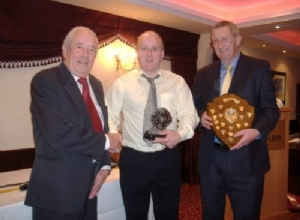 Club Men of the Year Fergal Marron and Seamus Kearney receive there awards from President James McAtamney