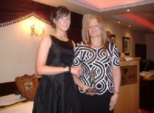 U18 Player of the Year Catherine O'Kane receives her award from Jackie McGuigan