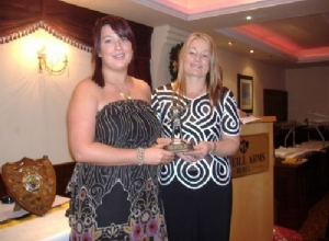 Junior Player of the Year Anna McAleese receives her award from Jackie McGuigan