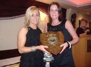 Senior Player of the Year Orla Donnelly receives her award from Bernie Grant