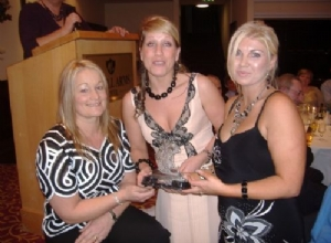 Jackie McGuigan present Club Persons of the year to Siobhan Grant and Carla Doherty