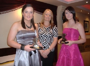 Jackie McGuigan presents special awards to Katie and Louise McAleese for winning College all Stars this year