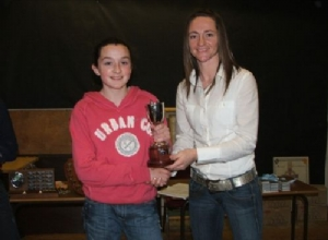 U12 Captain Emma McAleese receiving the U12 League Cup From Jane Adams