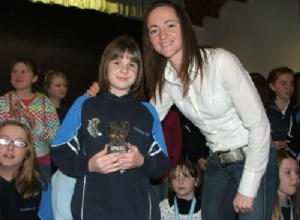 U12 Most Improved Player of the Year Kate Hagan receives her award from Jane Adams.