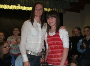 U12 Player of the Year Aine Mulholland  receives her award from Jane Adams