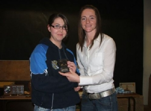 U14 Most Improved Player of the Year Orla McLaughlin receives her award from Jane Adams.