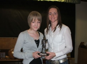 U14 Player of the Year Niamh Doherty  receives her award from Jane Adams