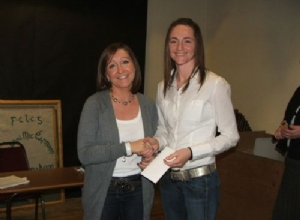 Club Secretary Paula McCloskey presents a gift to Camogie All Star Jane Adams
