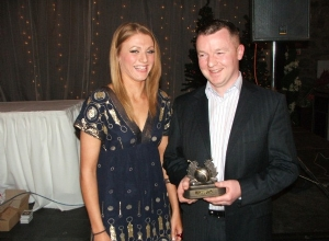 Paul McKee receives Camogie Clubperson of the Year from Grainne McGoldrick