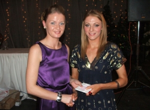 Chrissie Doherty presents Grainne McGoldrick a gift to thank her for attending.
