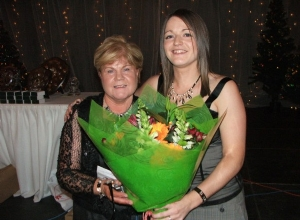 Mairead Graham presents Marie Doherty with flowers to thank her for the hard work and dedication to the club.