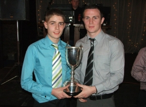 Declan Doherty receives U16 League Trophy from Michael McCann