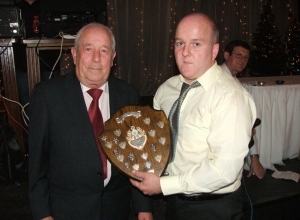 Fergal (Budgie) Marron  receives Clubman of the Year from club president Jamsie McAtamney