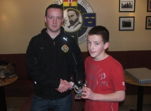 U14 Player of the Year Ronan Delargy receives his award from Paddy Carey