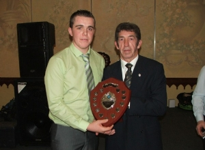 Minor Captain Niall Kelly receives Div 2 League Trophy from Leo Heatley