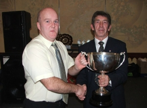 Chairman Fergal Marron receives trophy for best disciplined underage in SW Antrim from SW Chairman Leo HEatley