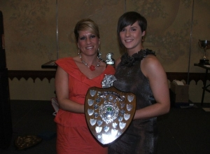 Senior POTY Catherine O'Kane receives her award from Siobhan Grant
