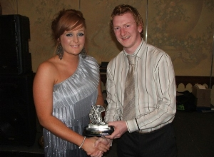 Reserve POTY Kiara Duffin receives her award from manager Kevin Kelly