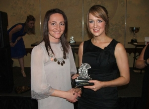U18 POTY Joanne Loughlin receives her away from Jane Adams