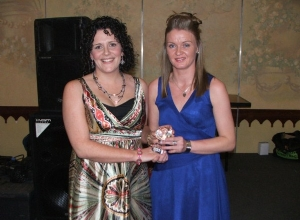 Clubperson of the year Clare Daly receives her award from Christine Doherty