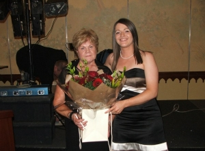 Mairead Graham presents Marie Doherty flowers in thanks for all her hard work with the club