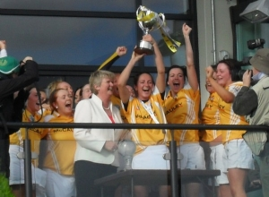 Team captain Jane Adams lifts the cup!